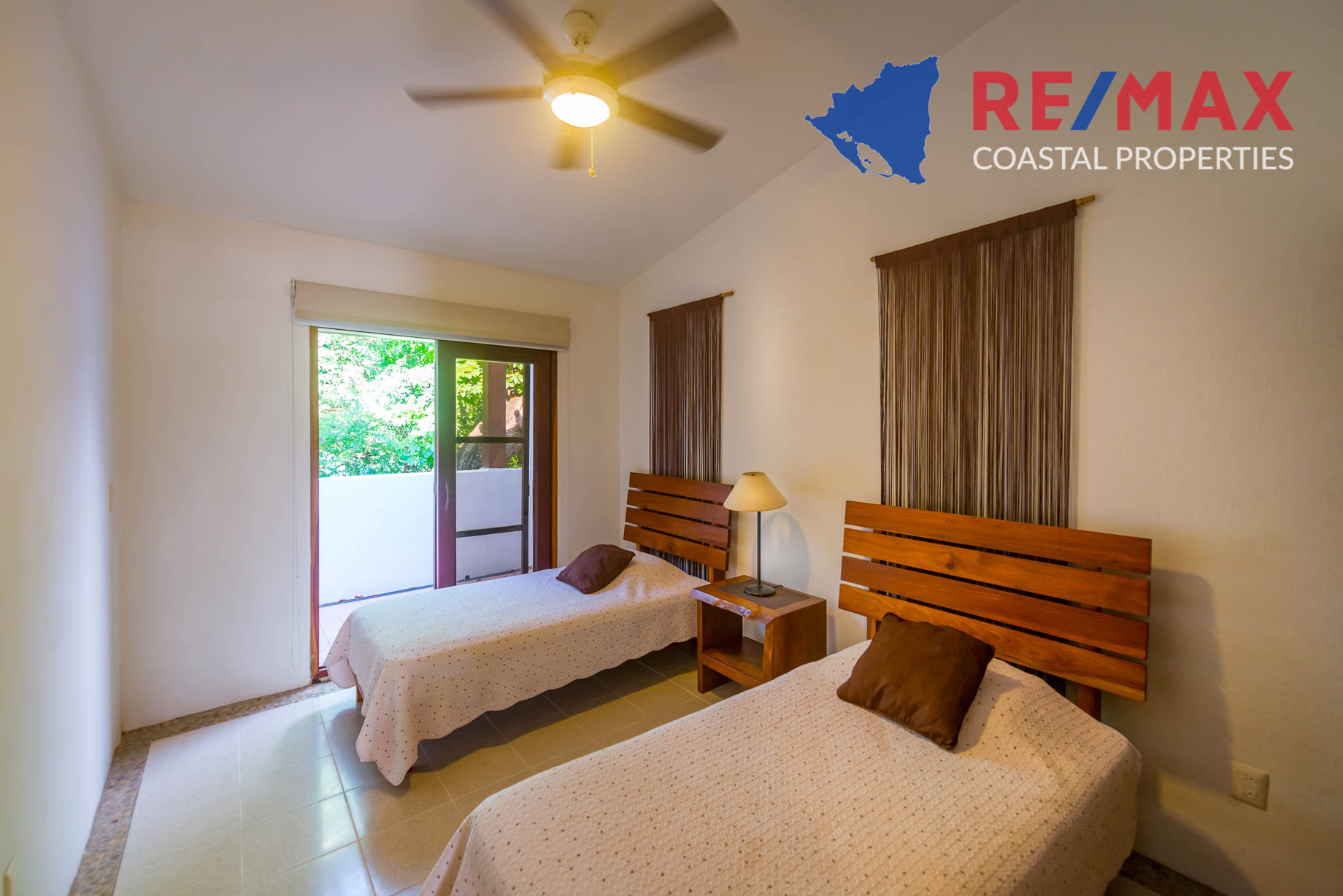 https://property-nicaragua.com/pedrodev/wp-content/uploads/2012/06/Playa-Coco-Townhome-2-REMAX-Coastal-Properties-29.jpg