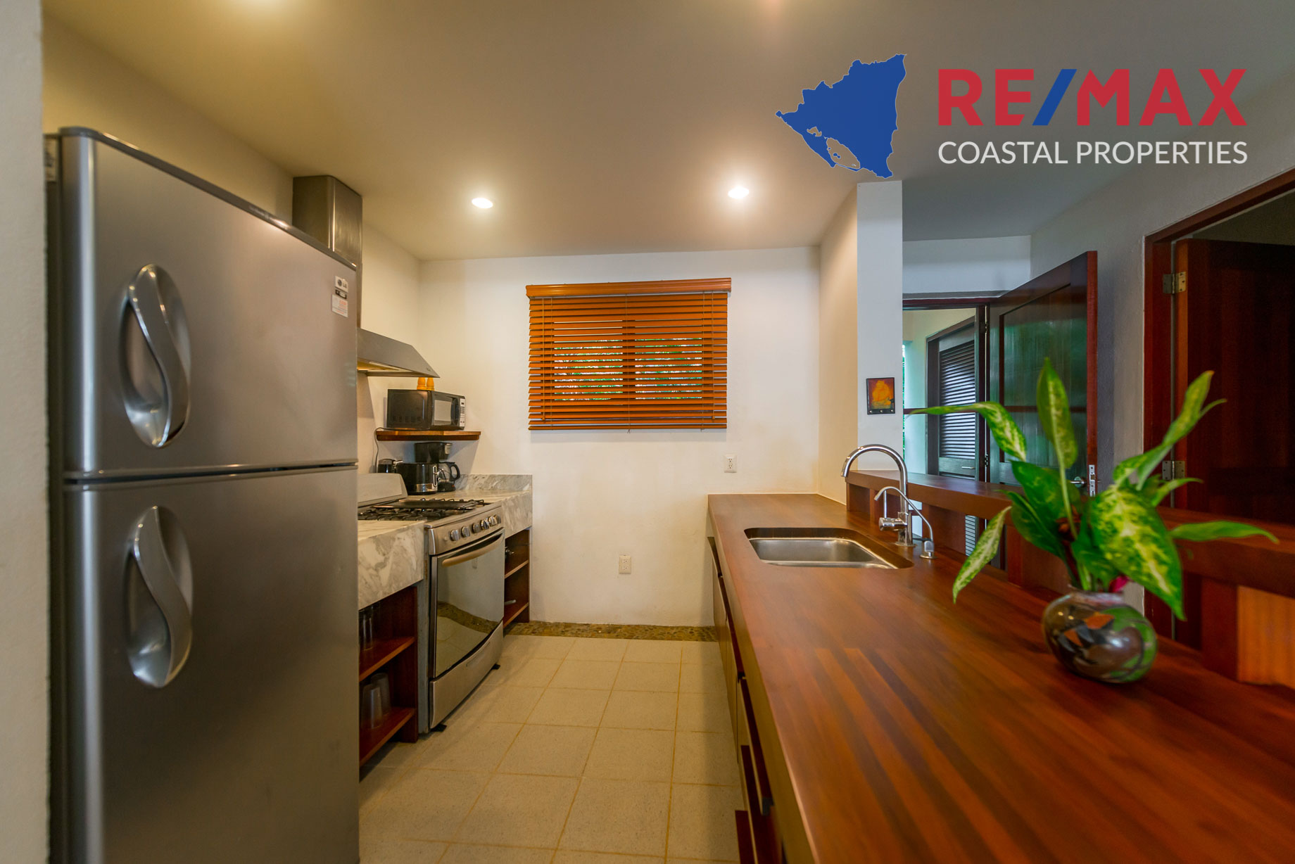https://property-nicaragua.com/pedrodev/wp-content/uploads/2012/06/Playa-Coco-Townhome-2-REMAX-Coastal-Properties-6.jpg