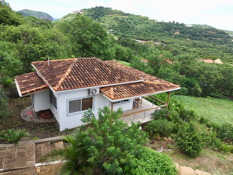 https://property-nicaragua.com/pedrodev/wp-content/uploads/2020/10/looking-out-from-deck-of-villa.jpg